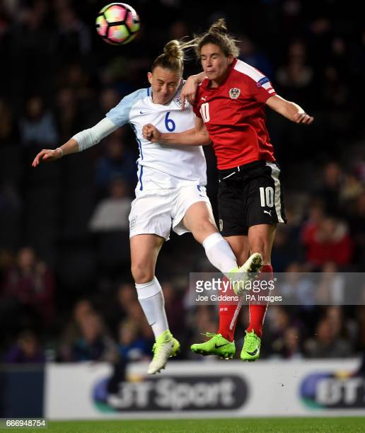 England's Laura Bassett and Austria's Nina Burger battle for the ball in the air during the International Friendly match at Stadium mk Milton Keynes
