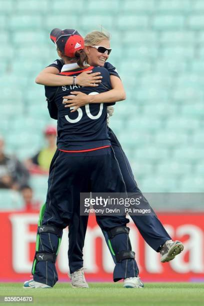 England's Laura Marsh celebrates after taking the wicket of Australia's Leah Poulton with wicketkeeper Sarah Taylor during the ICC Women's World...