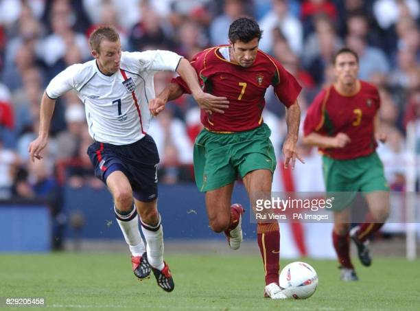 England's Lee Bowyer tussles with Portugal's Luis Figo during the International friendly match at Villa Park Birmingham THIS PICTURE CAN ONLY BE USED...