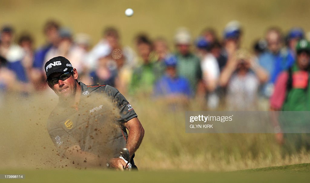 England's Lee Westwood hits a shot out of a bunker on the fifth during the second round of the 2013 British Open Golf Championship at Muirfield golf course at Gullane in Scotland on July 19, 2013. AFP PHOTO/ADRIAN DENNIS