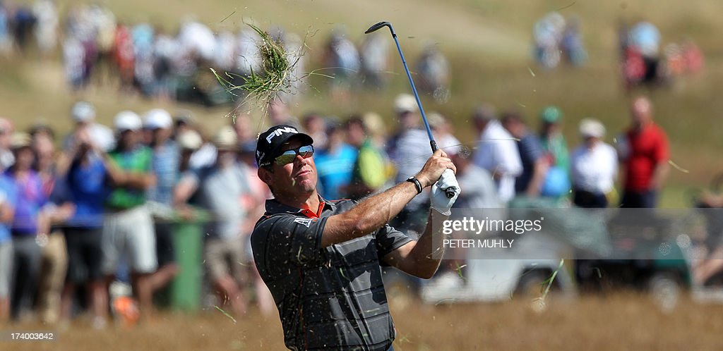 England's Lee Westwood plays a shot of the rough on the 14th during the second round of the 2013 British Open Golf Championship at Muirfield golf course at Gullane in Scotland on July 19, 2013 . AFP PHOTO/PETER MUHLY