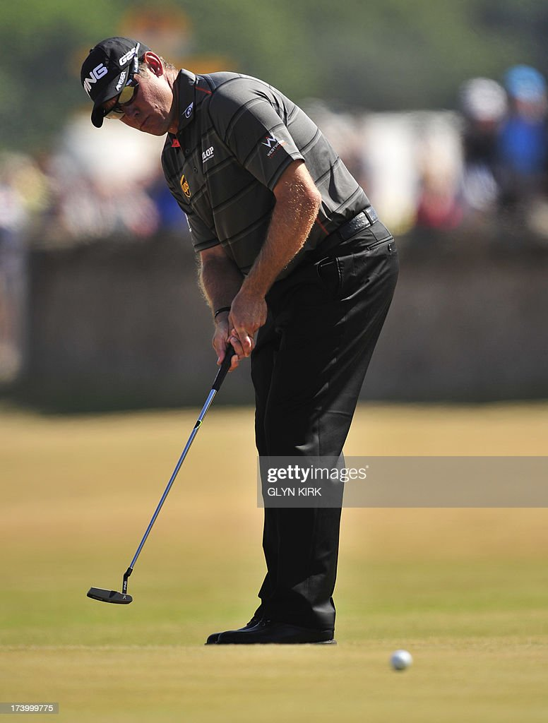 England's Lee Westwood putts on the ninth green during the second round of the 2013 British Open Golf Championship at Muirfield golf course at Gullane in Scotland on July 19, 2013 . AFP PHOTO/GLYN KIRK