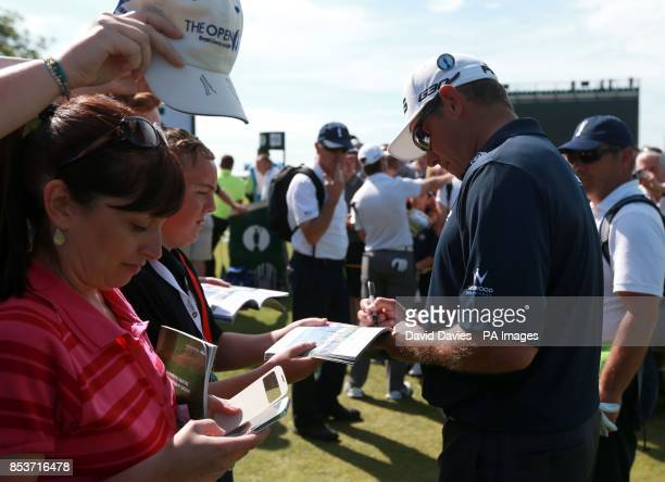England's Lee Westwood signs autographs during practice day three of the 2014 Open Championship at Royal Liverpool Golf Club Hoylake