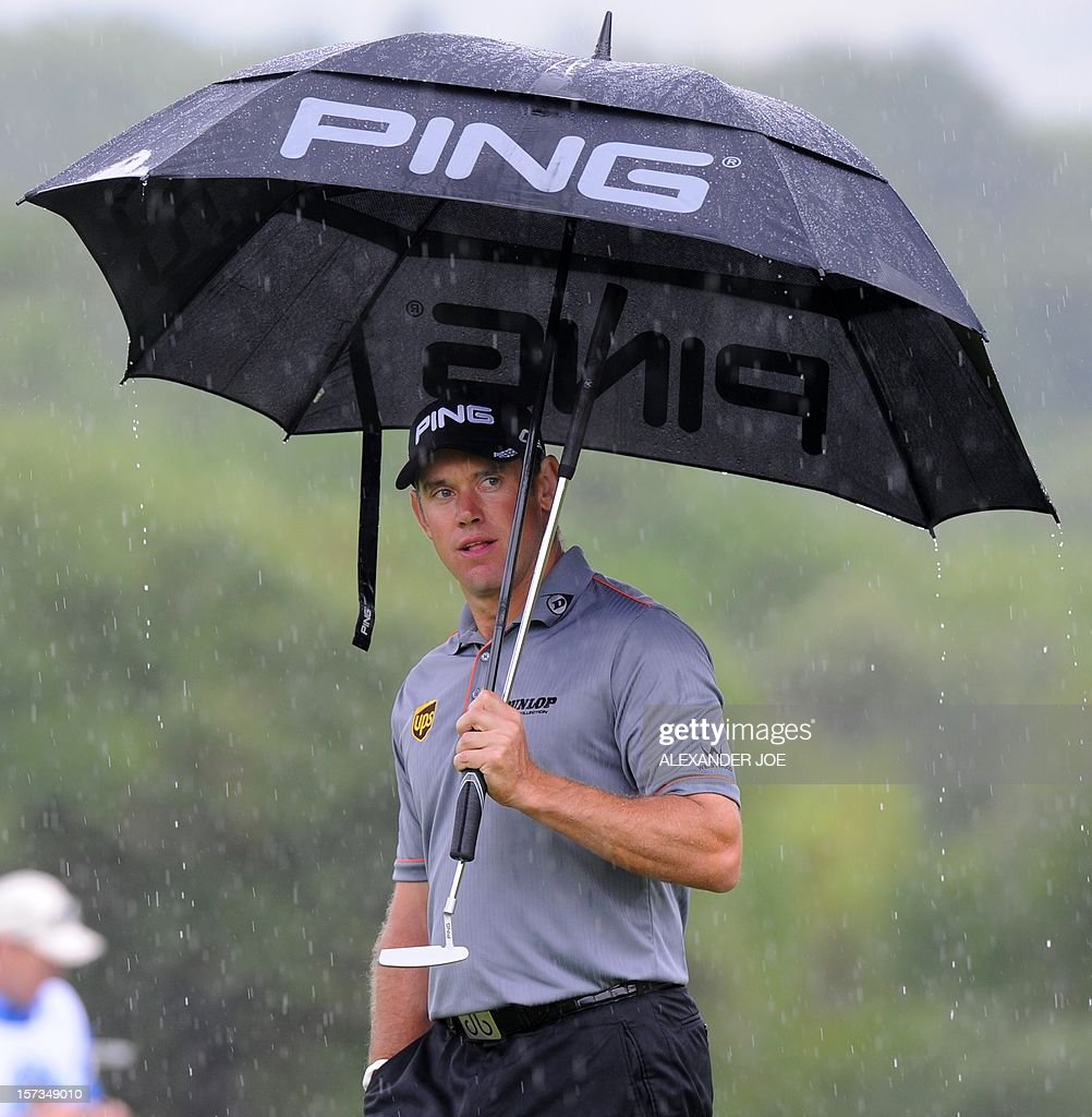 Englands Lee Westwood stands in the rain on the 7th during the 2012 Nedbank Golf Challenge in Sun City on December 2 ,2012. PHOTO / Alexander Joe