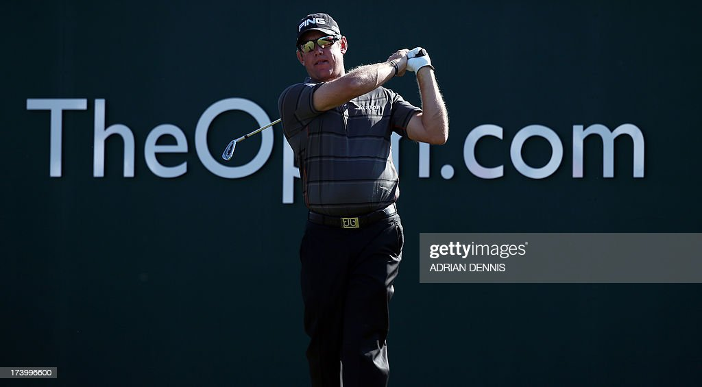 England's Lee Westwood watches his drive from the first tee during the second round of the 2013 British Open Golf Championship at Muirfield golf course at Gullane in Scotland on July 19, 2013 .