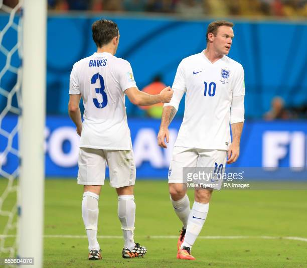 England's Leighton Baines and England's Wayne Rooney appear dejected after Italy's Claudio Marchisio scores his side's first goal of the game during...