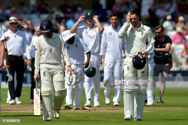 England's Liam Dawson and England's James Anderson leave the field as South Africa claimed victory on the fourth day of the second Test match between...