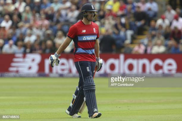 England's Liam Livingstone walks off the pitch after losing his wicket during the third Twenty20 international cricket match between England and...