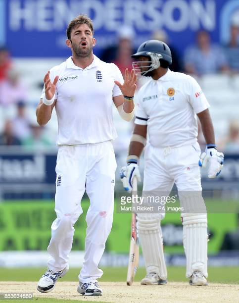 England's Liam Plunkett ahows his dejection after a missed chance against Sri Lanka with Kumar Sangakkara during day three of the second Investec...