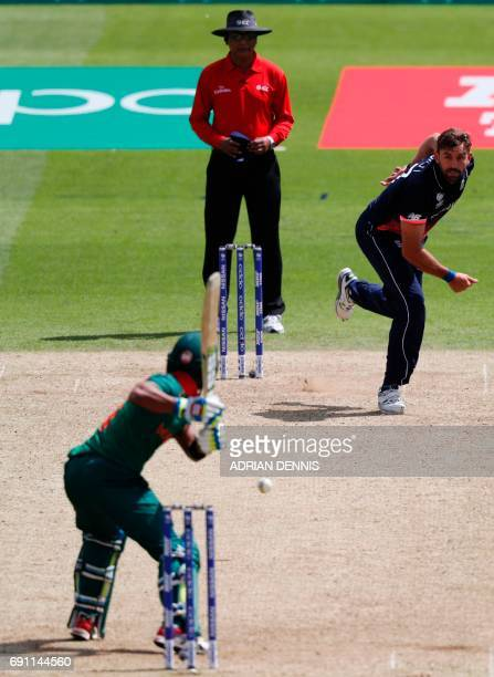 England's Liam Plunkett bowls to take the wicket of Bangladesh's Sabbir Rahman during the ICC Champions trophy cricket match between England and...
