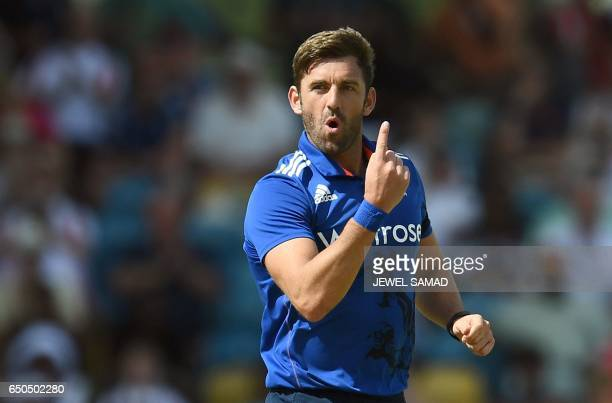 England's Liam Plunkett celebraets after bowling out West Indies cricketer Jason Mohammed during the final of the threematch One Day International...