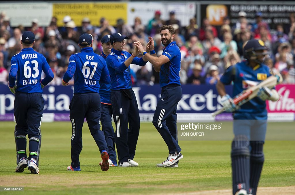 England's Liam Plunkett (2R) celebrates after bowling to take the wicket of Sri Lanka's Kusal Mendis, caught by England's Alex Hales, for 53 runs during play in the third one day international (ODI) cricket match between England and Sri Lanka at Bristol cricket ground in Bristol, south-west England, on June 26, 2016. / AFP / JON