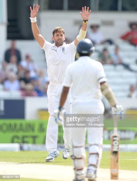 England's Liam Plunkett celebrates taking the wicket of Sri Lanka's Dimuth Karunaratne with Kumar Sangakkara during day three of the second Investec...