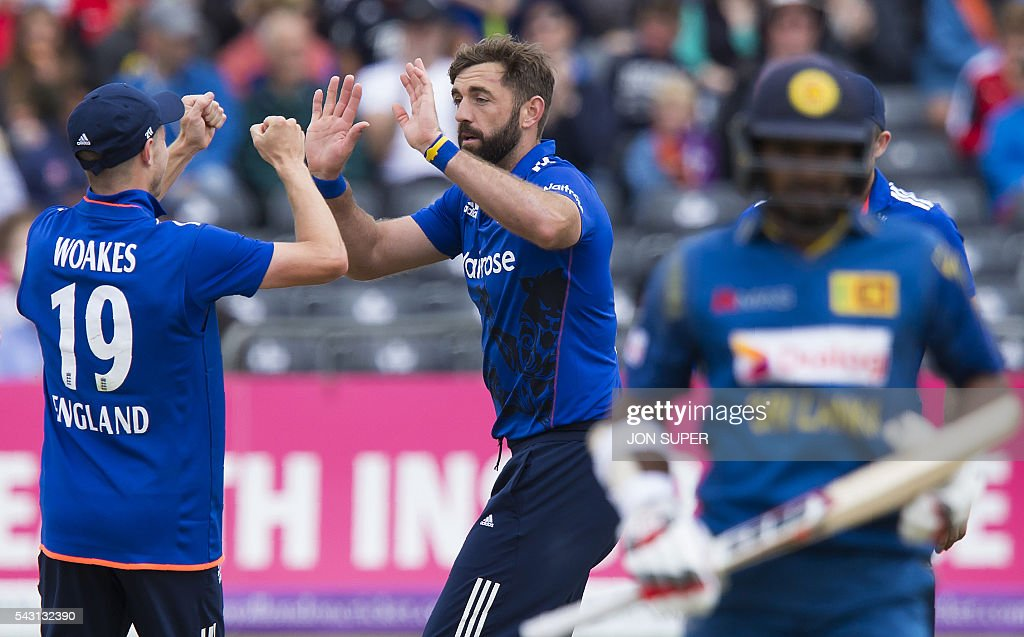 England's Liam Plunkett (C) celebrates with teammate Chris Woakes (L) after taking the wicket of Sri Lanka's Kusal Perera, caught by Jos Buttler for nine runs during play in the third one day international (ODI) cricket match between England and Sri Lanka at Bristol cricket ground in Bristol, south-west England, on June 26, 2016. / AFP / JON