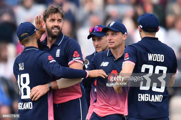 England's Liam Plunkett celebrates with teammates the wicket of South Africa's AB de Villiers for 52 during the second OneDay International between...