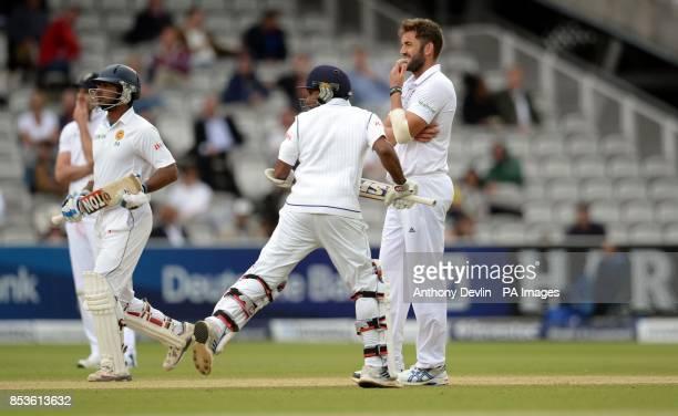England's Liam Plunkett reacts as Sri Lanka's Mahela Jayawardene and Kumar Sangakkara run between the wickets during day five of the Investec Test...