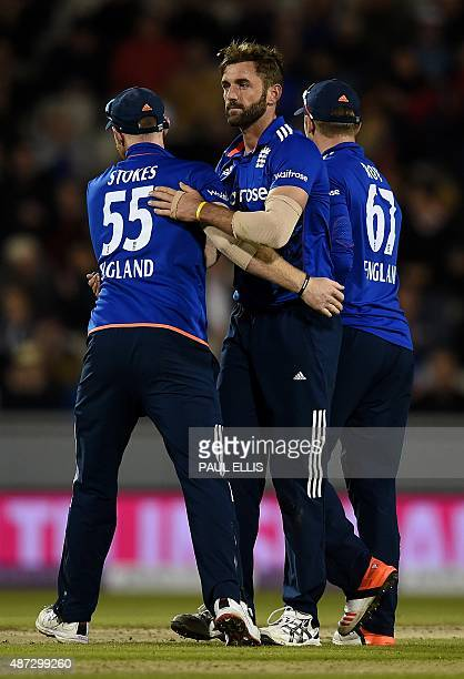 England's Liam Plunketton is congratulated by team mates Ben Stokes and Jason Roy for catchingout Australia's Mitchell Marsh for 13 runs off the...