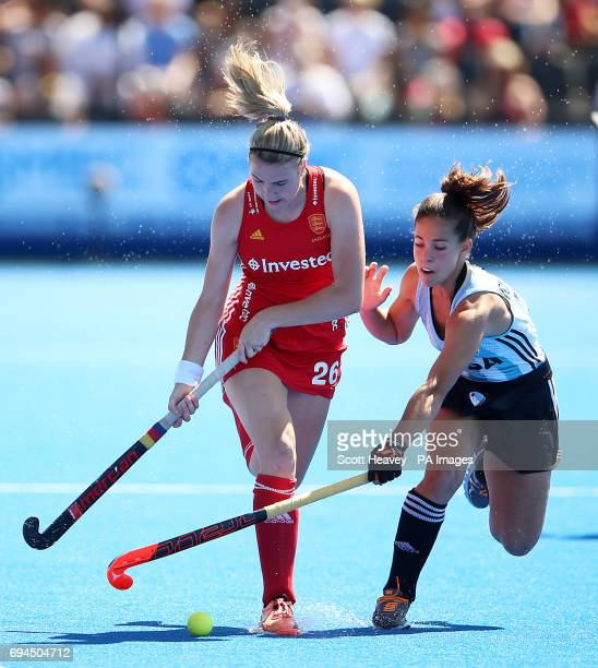 England's Lily Owsley and Argentina's Lucina von der Heyde during the Investec International match at Lee Valley Hockey Centre London