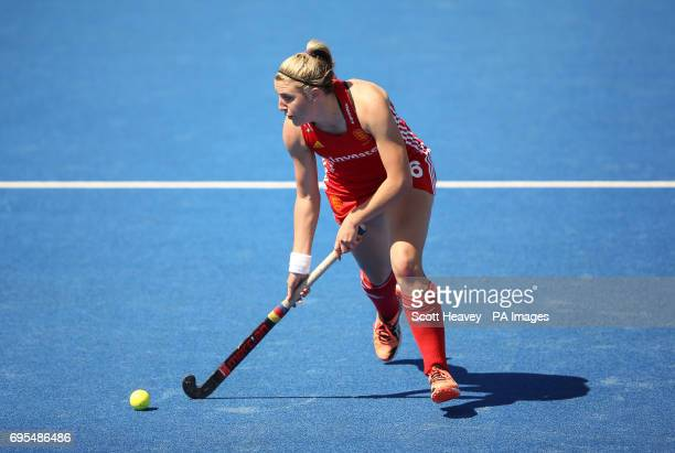 England's Lily Owsley celebrates during the Investec International match at Lee Valley Hockey Centre London