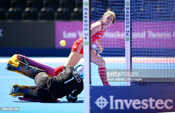 Englandâs Lily Owsley shoots wide past Argentinaâs Belen Succi during the Investec International match at Lee Valley Hockey Centre London