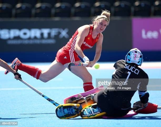 Englandâs Lily Owsley shoots wide past Argentinaâs Belern Succi during the Investec International match at Lee Valley Hockey Centre London