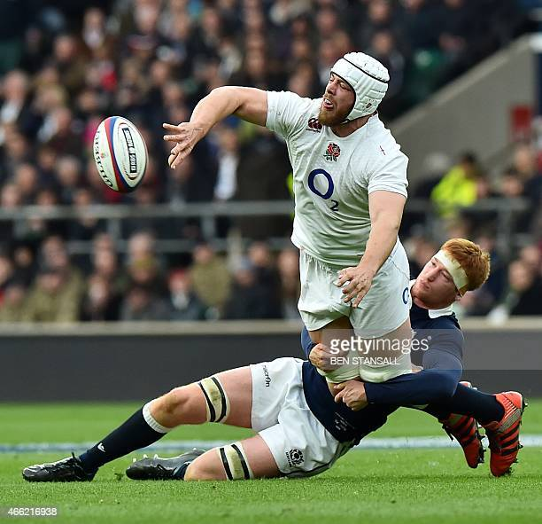 England's lock Dave Attwood is tackled by Scotland's flanker Rob Harley during the Six Nations international rugby union match between England and...
