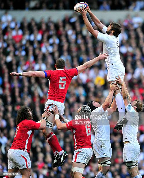 England's lock Geoff Parling beats Wales' lock Ian Evans to the ball in a lineout during the 6 Nations International rugby union match between...