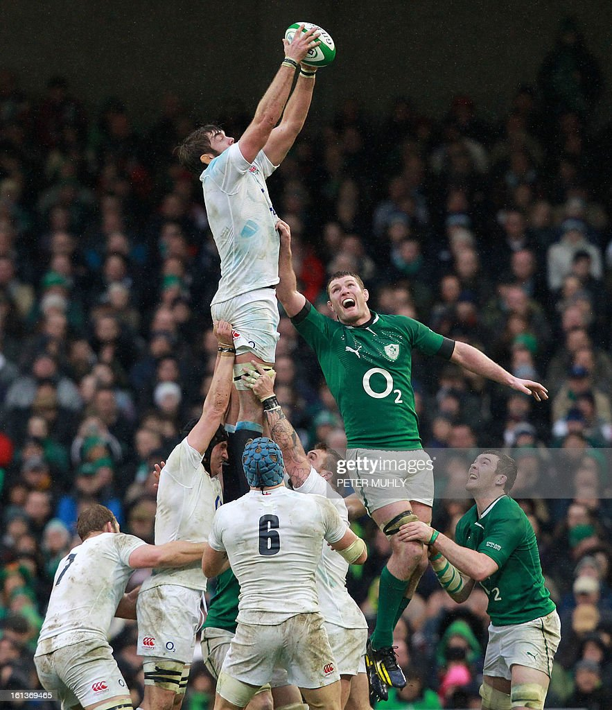 England's lock Geoff Parling (up L) gets to the ball before Ireland's prop Cian Healy (up R) to win a line out during the Six Nations international rugby union match between Ireland and England at Aviva Stadium in Dublin on February 10, 2013. England won 12 - 6. AFP PHOTO / PETER MUHLY