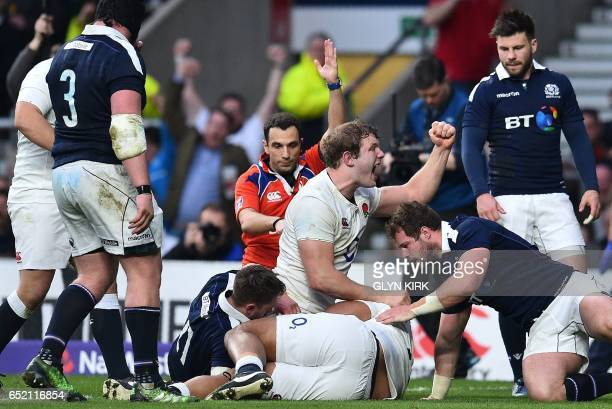 England's lock Joe Launchbury celebrates as England's Billy Vunipola scores his team's fifth try during the Six Nations international rugby union...