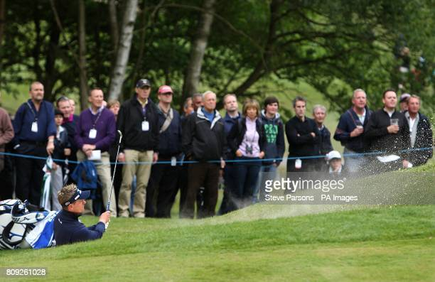 England's Luke Donald plays out of a sand trap during the second round of the BMW PGA Championship at Wentworth Golf Club Surrey