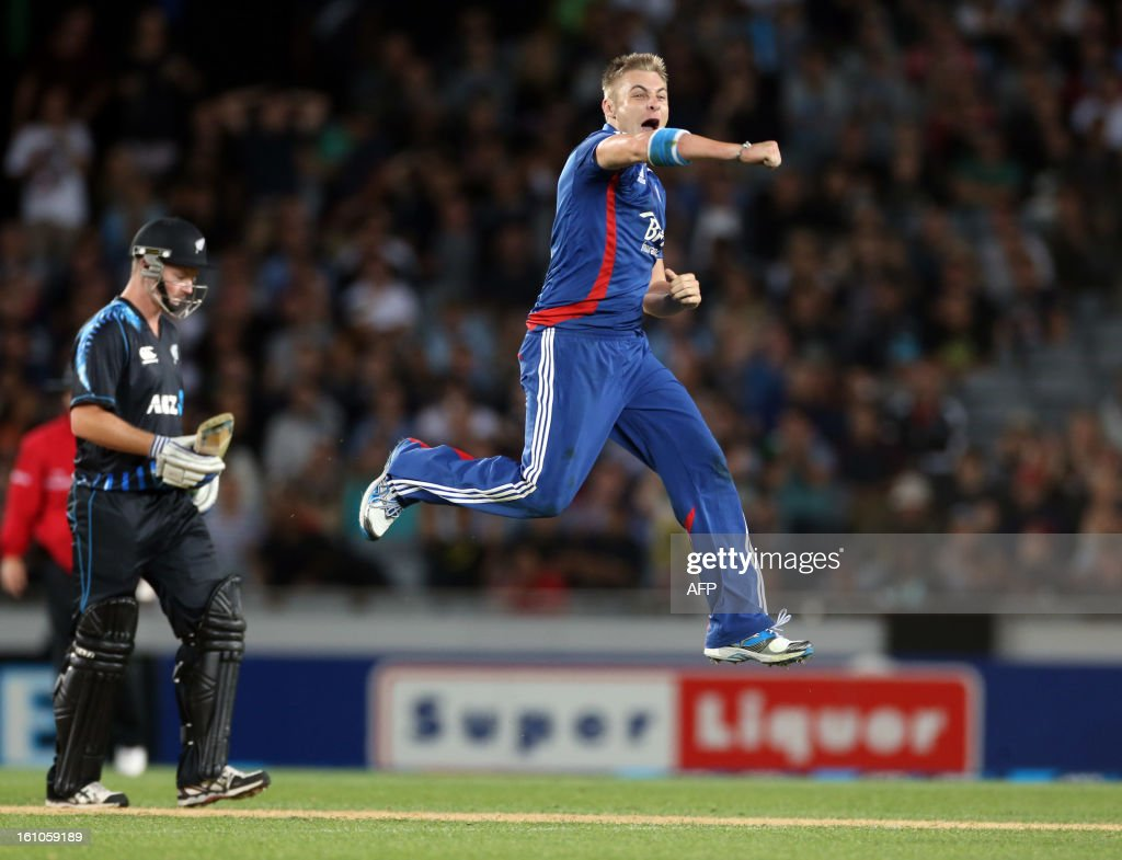 England's Luke Wright celebrates the wicket of New Zealand's Martin Guptill (note pictured) as New Zealand's Colin Munro looks on (L) during the International Twenty20 cricket match between New Zealand and England played at Eden Park in Auckland on Febuary 9, 2013. AFP PHOTO / Michael BRADLEY