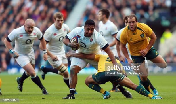 England's Mako Vunipola is tackled by Australia's Will Genia during the QBE International at Twickenham London