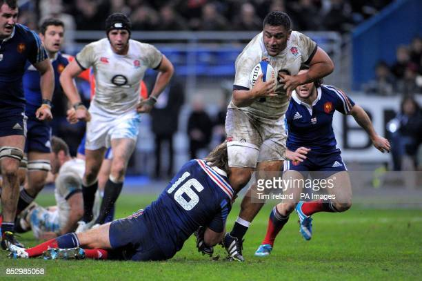 England's Mako Vunipola is tackled by France's Dimitri Szarzewski during the RBS 6 Nations match at the Stade de France Paris France