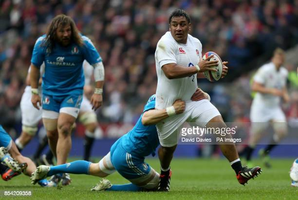 England's Mako Vunipola is tackled by Italy's Alessandro Zanni during the RBS Six Nations match at Twickenham London