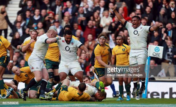 England's Mako Vunipola leads the celebrations as Chris Robshaw scores their first try during the QBE International at Twickenham London