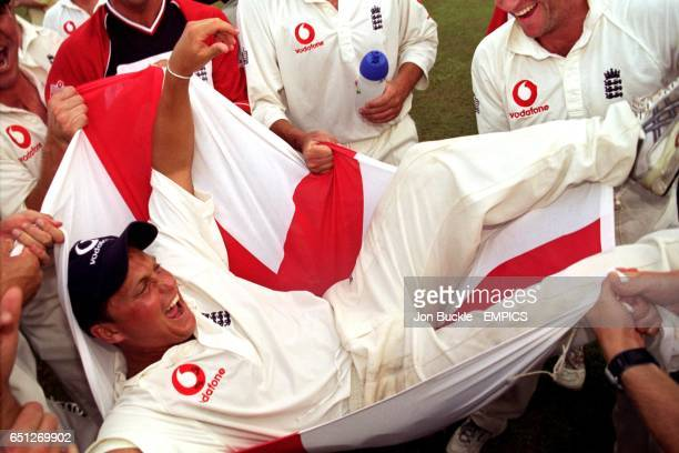 England's Man of the Series Darren Gough is given the bumps in a St George's flag as the England team celebrate their test and series victory