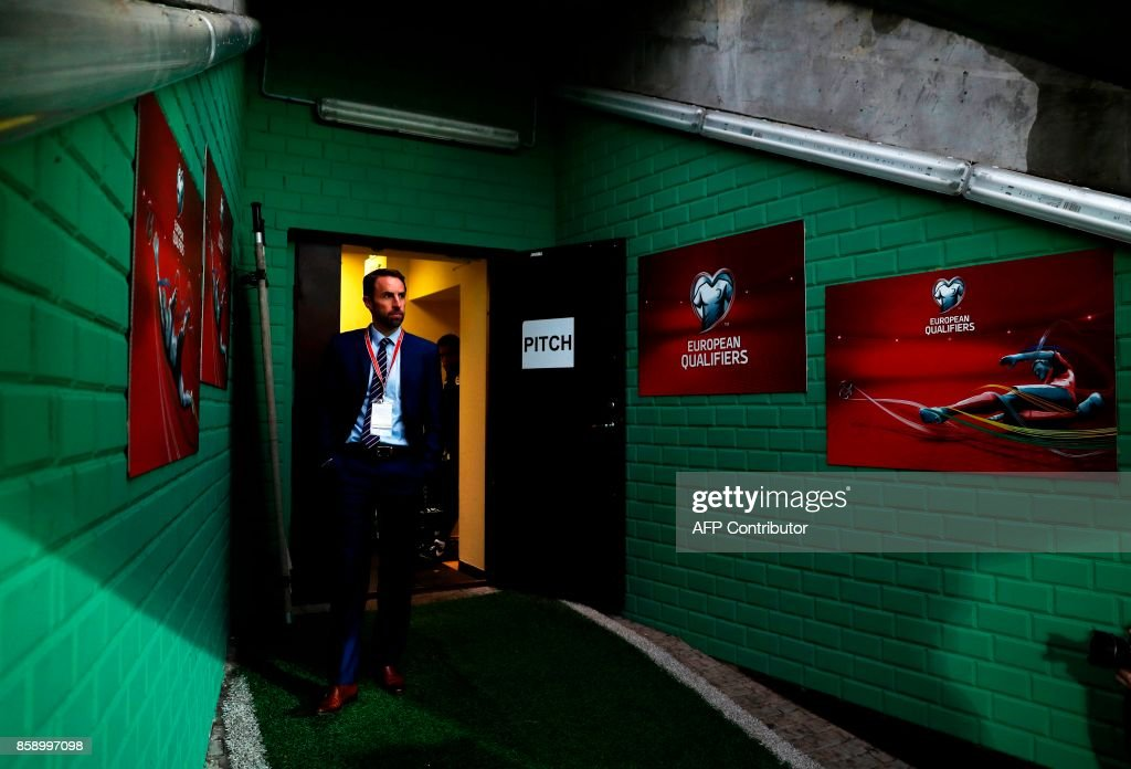 TOPSHOT - England's Manager Gareth Southgate walks out of the tunnel to look at the pitch at LFF stadionas ahead of the match against Lithuania during the 2018 FIFA World Cup European Qualifying match on October 8, 2017 in Vilnius Lithuania. /