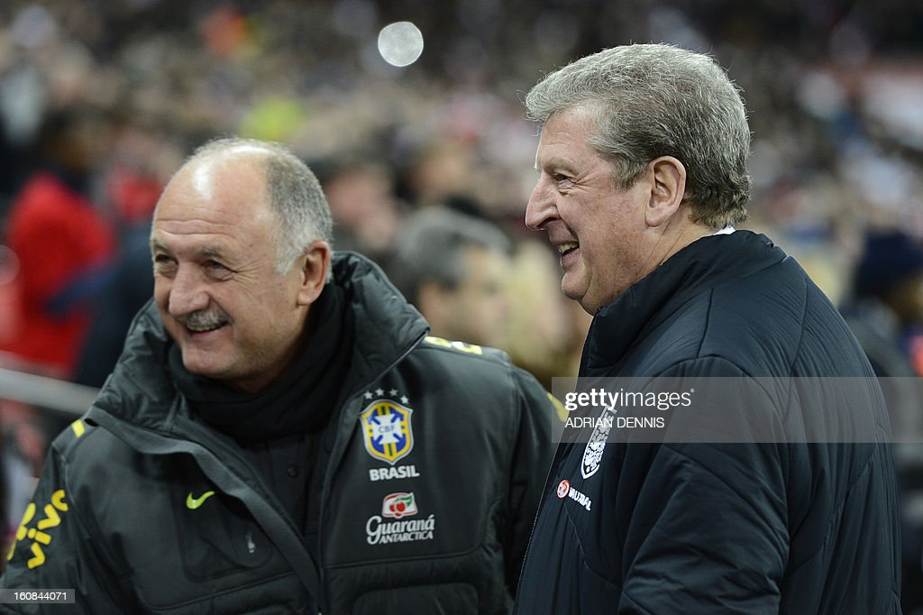 England's manager Roy Hodgson (R) greets Brazil's manager Felipe Scolari (L) before the start of the international friendly football match between England and Brazil at Wembley Stadium in north London on February 6, 2013. England won 2-1.