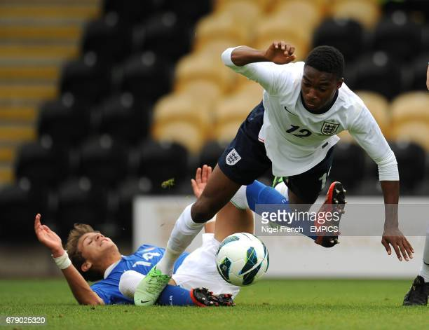 England's Mandela Egbo is tackled by Italy's Manuel Locatelli