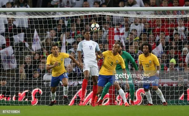 England's Marcus Rashford and Brazil's Miranda during the Bobby Moore Fund International between England and Brazil at Wembley Stadium on November 14...