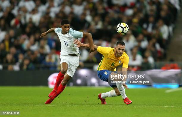 England's Marcus Rashford and Brazil's Renato Augusto during the Bobby Moore Fund International between England and Brazil at Wembley Stadium on...