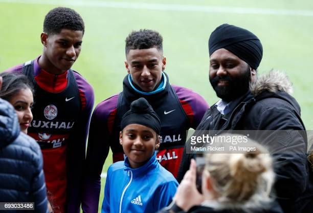England's Marcus Rashford and Jesse Lingard pose for a photo during the training session at St George's Park Burton