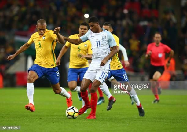 England's Marcus Rashford and Miranda of Brazil during International Friendly match between England and Brazil at Wembley stadium London on 14 Nov...
