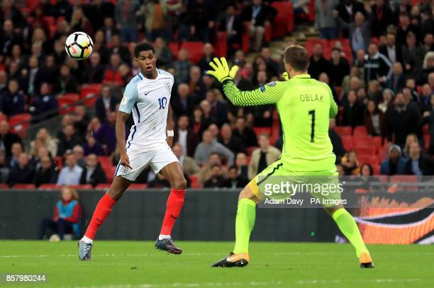 England's Marcus Rashford attempts to chip the ball over Slovenia's Jan Oblak during the 2018 FIFA World Cup Qualifying Group F match at Wembley...
