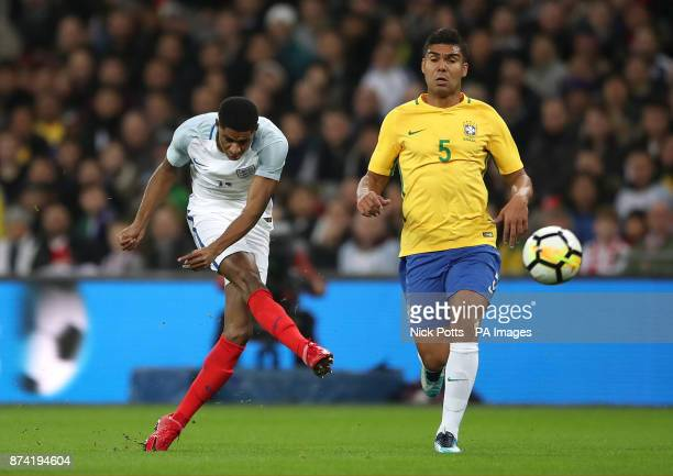 England's Marcus Rashford has a shot on goal under pressure from Brazil's Casemiro during the Bobby Moore Fund International match at Wembley Stadium...