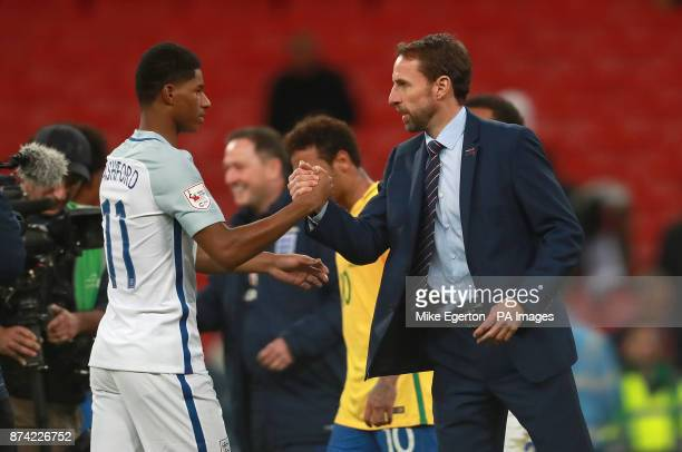 England's Marcus Rashford shakes hands with manager Gareth Southgate after the Bobby Moore Fund International match at Wembley Stadium London