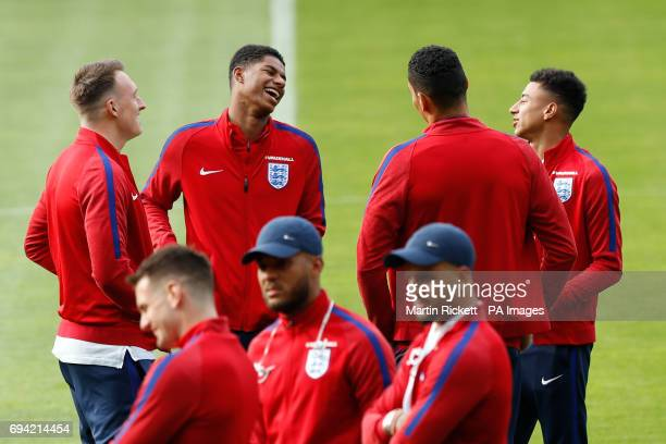 England's Marcus Rashford shares a joke with Jesse Lingard during a squad walk around at Hampden Park Glasgow