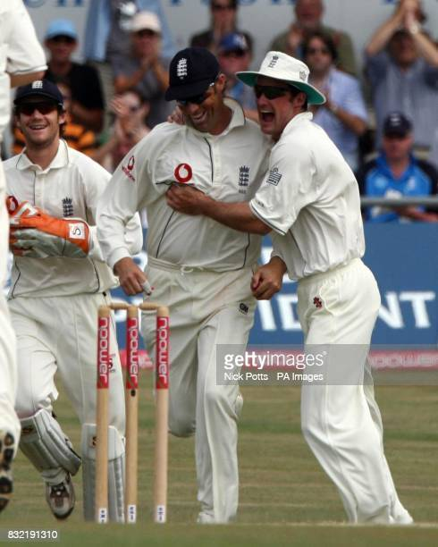 England's Marcus Trescothick celebrates his catch with captain Andrew Strauss after taking the wicket of Pakistan's Salman Butt during the fifth day...