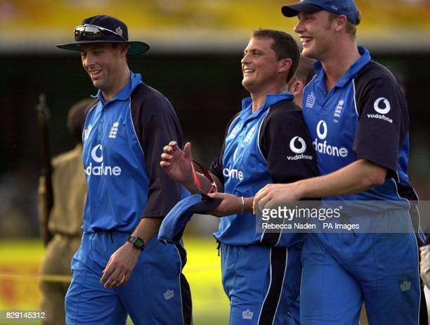 England's Marcus Trescothick Darren Gough and Andrew Flintoff leave the field after winning the oneday international against India at the Barabati...