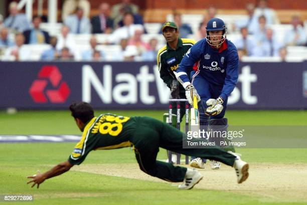England's Marcus Trescothick gets the ball past Pakistan's Mohammad Hafeez in his innings during the third NatWest Challenge match at Lords St John's...